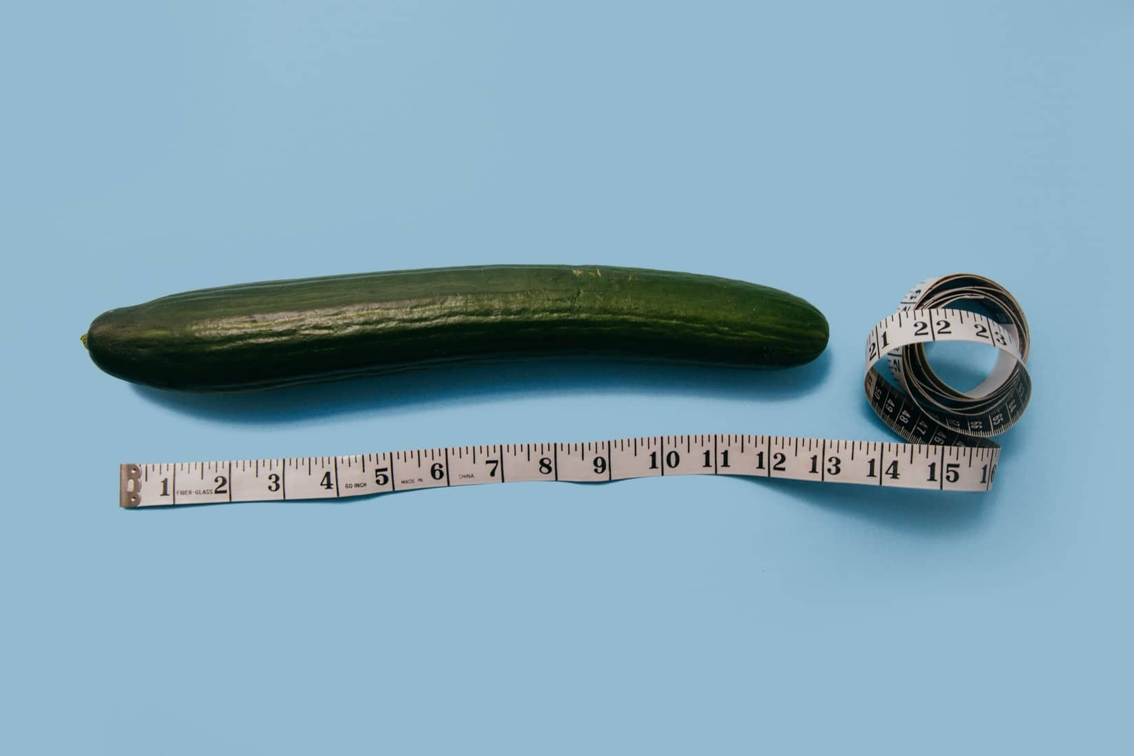 Photo of a cucumber with a tape measure beside it.